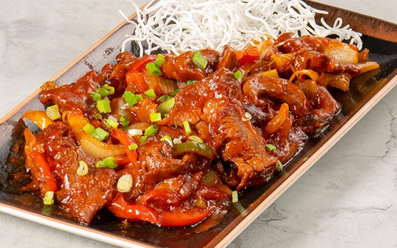 Кусочки филе говядины в чесночном соусе